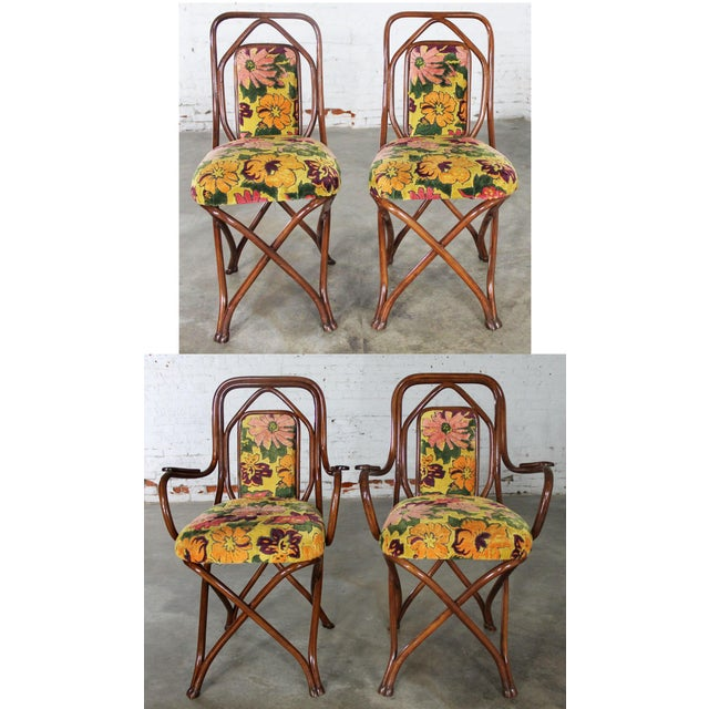 Incredible set of four circa 1850s Gebruder Thonet Bentwood dining chairs. This set consists of two arm chairs and two...