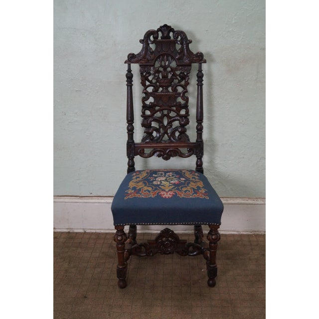 Antique carved Renaissance style highback side chair. High quality, solid walnut carved chair with needle point seat. Made...