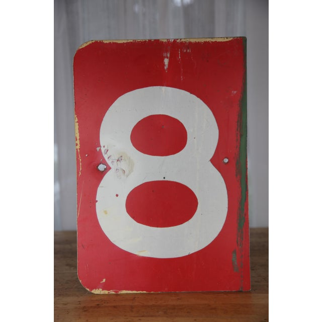 Super cool vintage metal sign featuring a large white number 8 contrasted against saturated red. Sign originally used at...