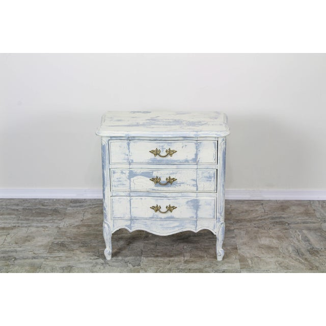 These nightstands have been nicely hand-painted in light gray and cream with distressed finish and metal hardware. Solid...
