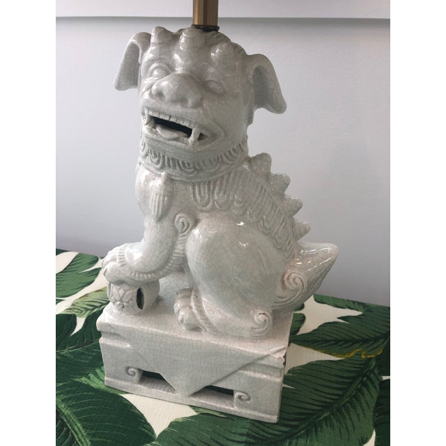 Very cool mid-century foo dog lamp. The shade and finial are NOT vintage and purchased more recently. Lamp is in good...