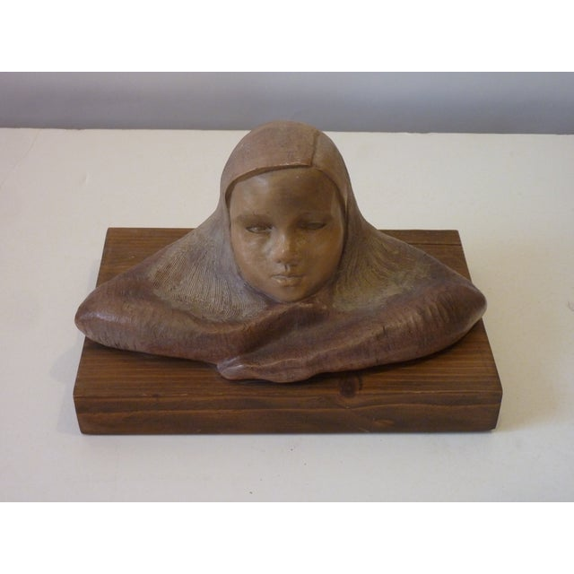 """20th Century ceramic sculpture of a girl with long hair in sgrafito, signed on the back, """"Richman '89"""", mounted on a block..."""