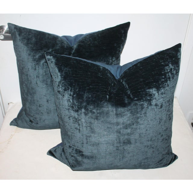 This pair of great indigo blue velvet pillows with linen backing and down and feather inserts. The velvet textile is in...