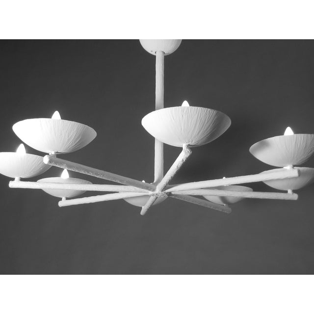 Eight spoke, eight light & eight cup chandelier. Up light. Can be ceiling fixture or chandelier length. Plaster and steel...