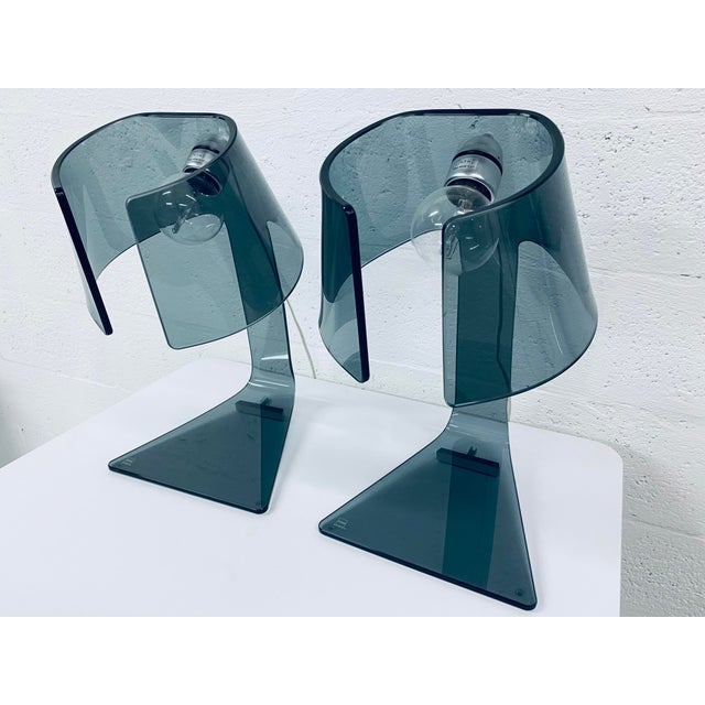 Two smoked gray glass L'astra desk or table lamps with 8 mm-thick curved transparent glass and brill aluminum lamp holder...