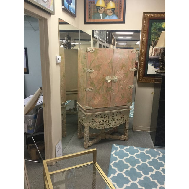 Wonderful floral armoire with all over floral print. This items is two pieces with the top of the armoire sitting on the...