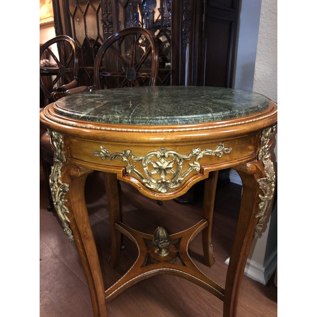 Fine French Ormolu Mounted Side Tables. A fine 19th century French ormolu mounted, mahogany round side table. Mahogany,...
