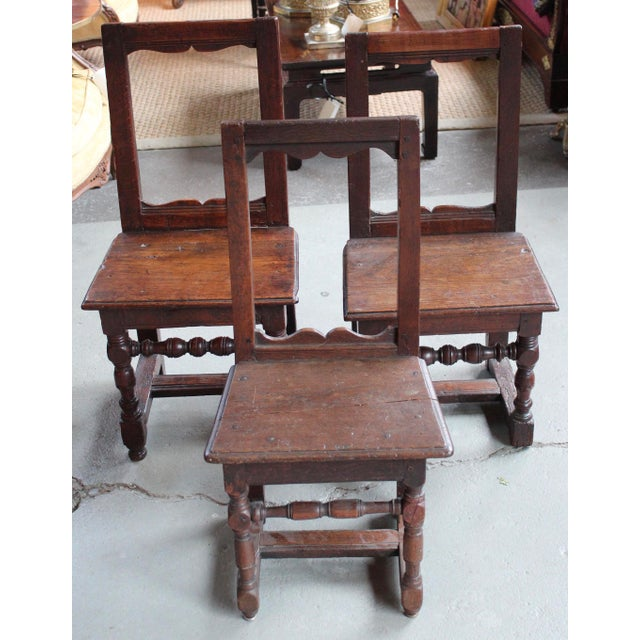 "Assembled set of three French oak ""Nuns"" chairs circa 1700. All very similar but not exactly the same. Dimensions are for..."
