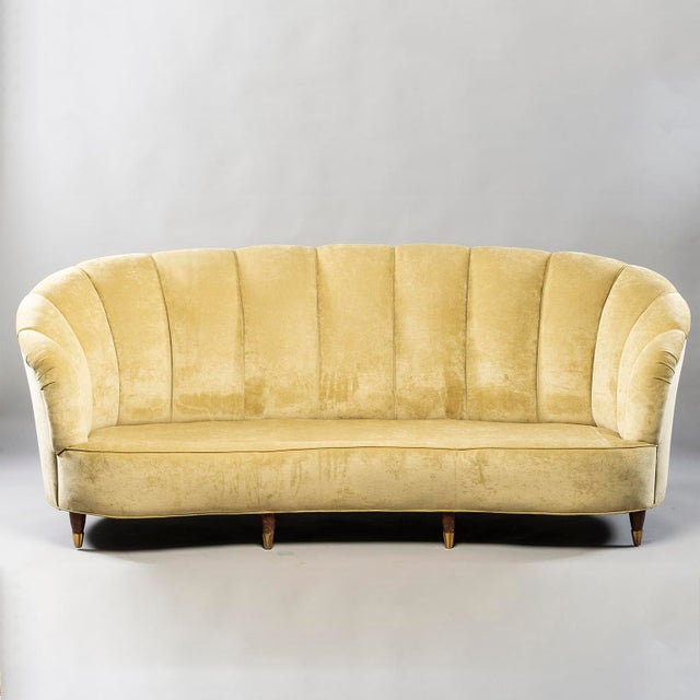 Sofa and chairs trio found in Italy and attributed to Paolo Buffa, circa 1940s. Coquille (shell) form channel back sofa...