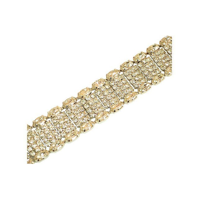 Offered here is a Weiss rhodium-plated crystal bracelet from the 1950s. The supple construction consists of a linked-box...