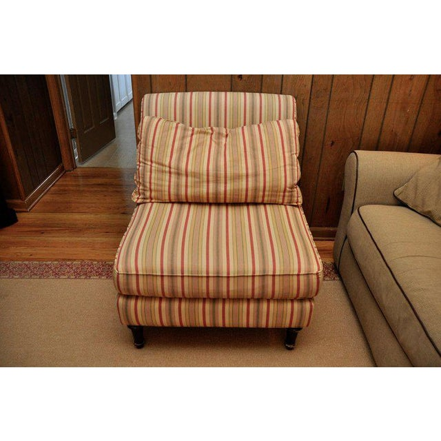 Striped slipper chair from Lillian August with accent pillow for extra comfort is ideal in any seating area next to a...