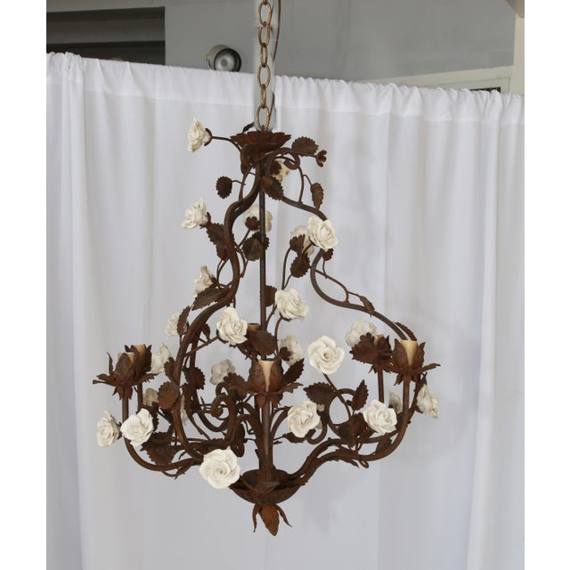 Gorgeous hand made rustic Italian chandelier with white ceramic flowers. Rewired, wax candle holders. Standard chandelier...
