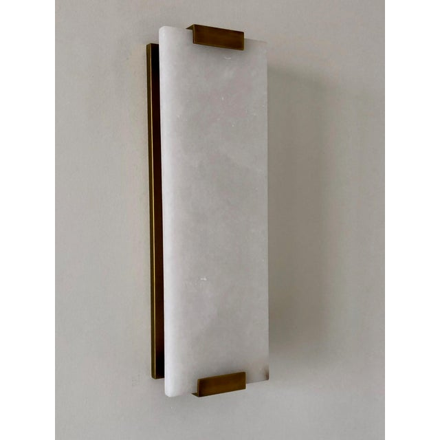 Elegant, Hand-Carved Alabaster sconce from Restoration Hardware. Made of luxe materials. Hand carved from a solid piece of...