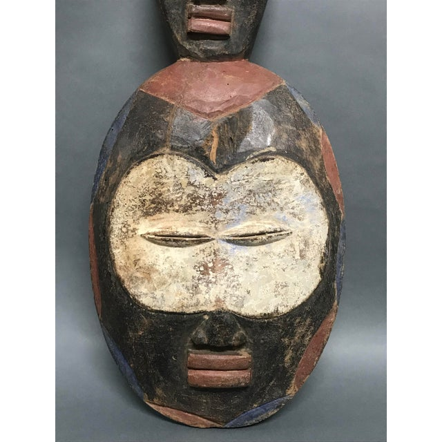 """African Art Tribal Art Kwele Mask AGES: 21st Century MATERIALS: Wood Pigments COUNTRY: Gabon DIMENSIONS: 18"""" High X 9.5""""..."""