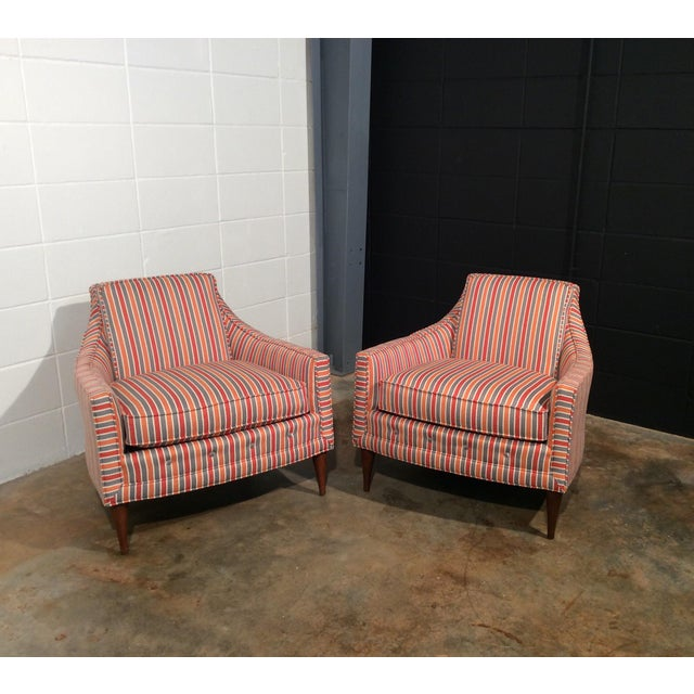 Pair of completely restored low back vintage lounge chairs. New striped upholstery in shades of gray, cream, orange and...