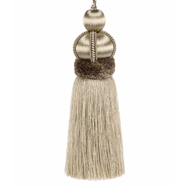 Bisque colored, satin beaded key tassel is made with cut ruche, decorative gimp and has a twisted cord detail. Total...