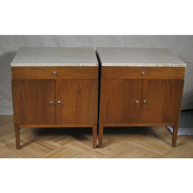 Paul McCobb walnut nightstands or end tables with travertine stone tops. Each features a single top drawer with a lower...