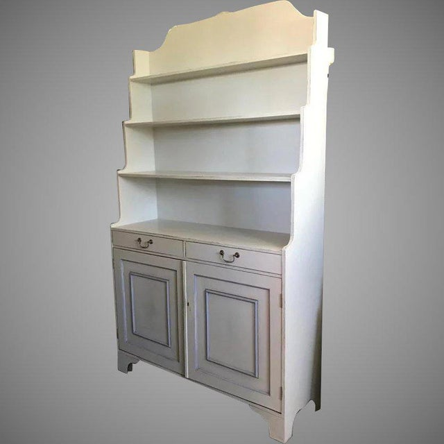 "Nice painted two drawer two door bookcase. Molded doors fronts. Some wear to paint. (later paint) Measures 48"" wide by 15..."