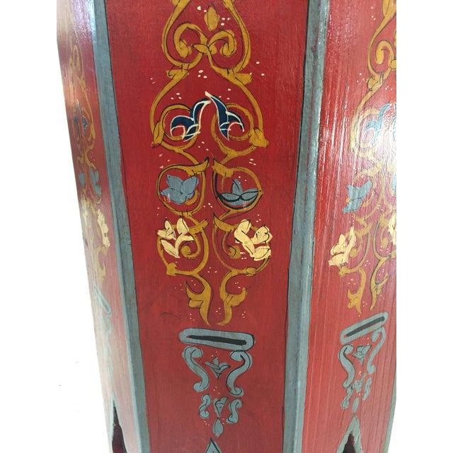 Pair of Moroccan vintage pedestal tables, hand-painted on a red background with floral and geometric designs in blue and...