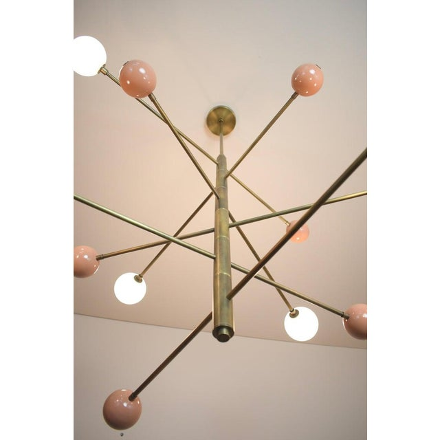 Handcrafted in NYC, our 'Orbital' Chandelier is a commanding statement piece with design elements of both Italian and...