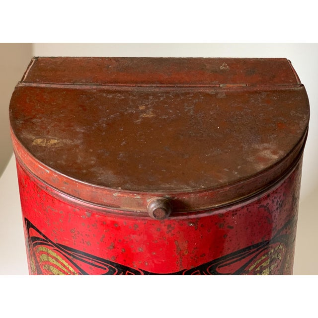 This vibrant red art deco style tin would have been used to sell coffee in a store setting. At 20 inches high it makes a...