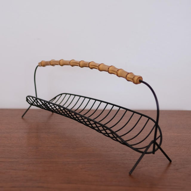 Wire fruit basket with cane handle. 1950s.