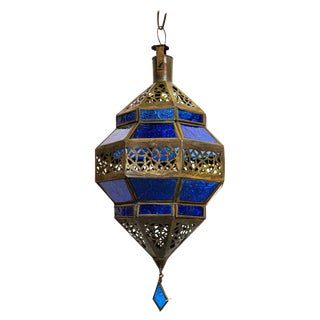 Handcrafted Moroccan Metal and Blue Glass Lantern, Octagonal Diamond Shape For Sale