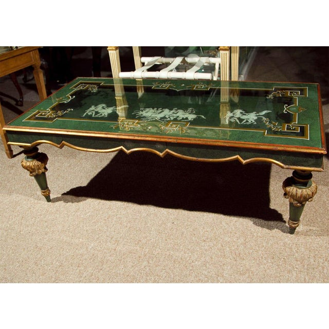 """Interesting green painted and parcel-gilt coffee table, 20th century, the rectangular glass top reveals to a """"shadow box""""..."""