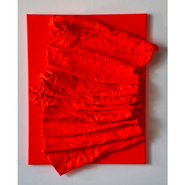 """""""Fluorescent Fire Red Folds"""" is a mixed media wall sculpture made with burlap and paint on linen. The elegant folds are..."""