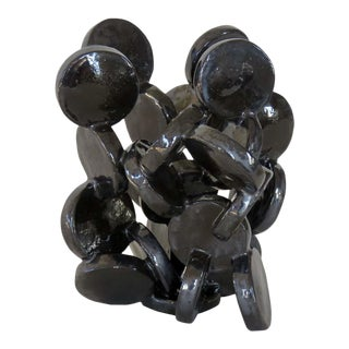 Abstract Ceramic Sculpture of Black Discs. For Sale