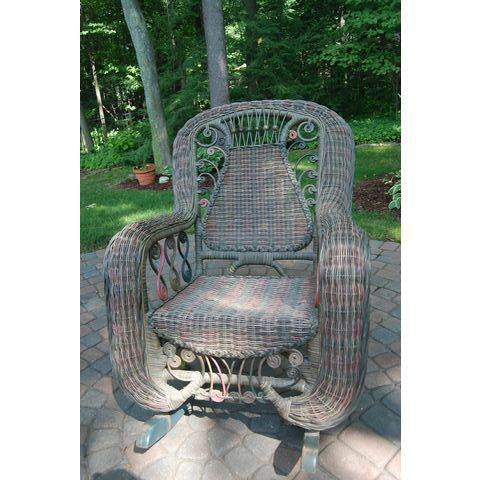 This chair is a lovely reproduction of an early 1900s wicker rocker in very good condition. It was handwoven in the...