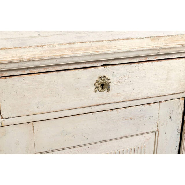 Early 19th century cream painted Gustavian sideboard.