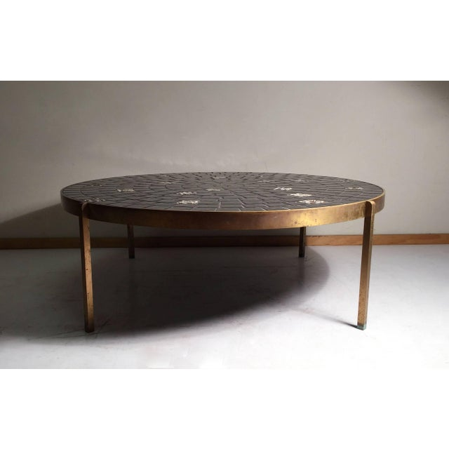 Vintage coffee table attributed to Mosaic House. Exceptionally high quality materials and construction. Solid bar brass...