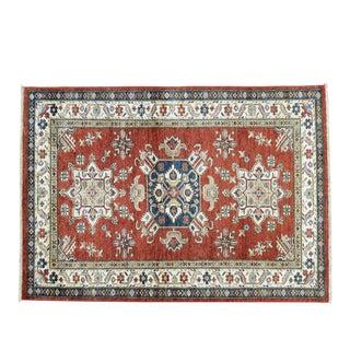 Hand-Knotted Tribal Design Kazak Rug- 4′1″ × 5′9″ For Sale