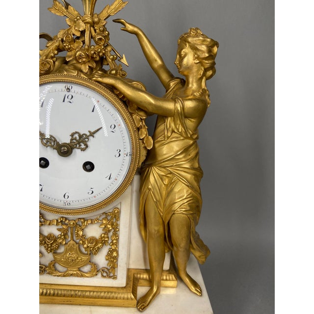 This is a unique, authentic antique French table or mantel clock. It was made around 1780. It has a white enamel dial,...