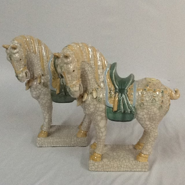 These Mid-Century Ceramic Crackle Horses are in great condition. Beautiful pieces that will add to your decor!