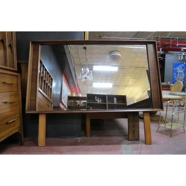 Large walnut framed mirror with rosewood side trim. Has matching credenza/dresser, chest of drawers, and queen size...