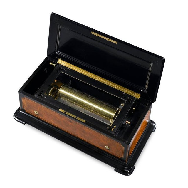 This music box manufactured by Brémond, one of the most respected and talented makers of the era, demonstrates not just...