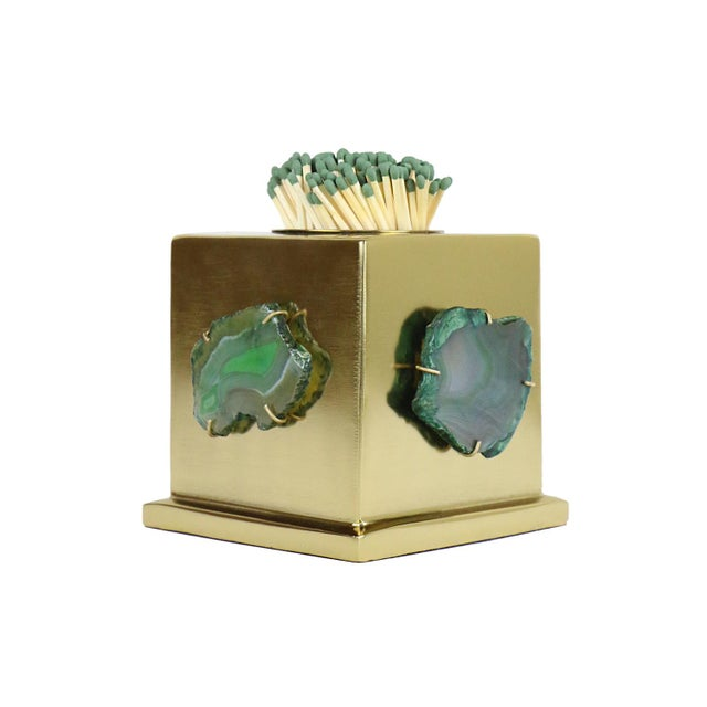 Satin Brass match striker with green agates. Matches not included