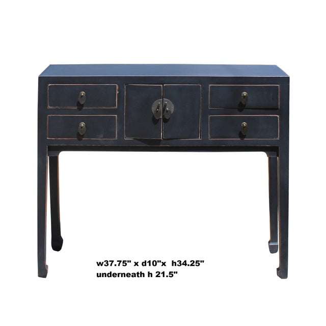 This is a simple black lacquer console side table with straight leg design. Drawers are decorated with Asian style handle....