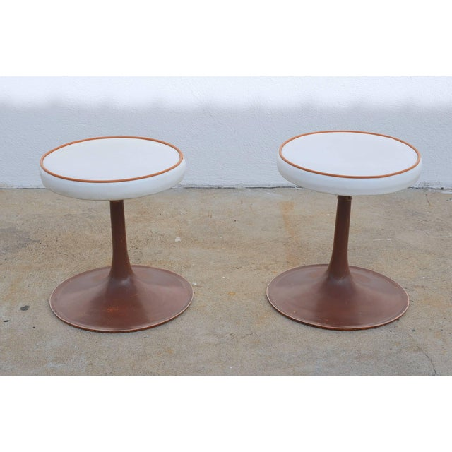 Pair of cast aluminum upholstered swiveling stools by Thinline. In the style of Saarinen's tulip stool. The have the...