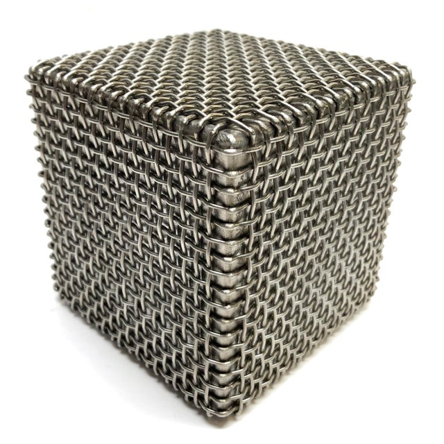 Modern cube sculpture with a mesh wire woven seamlessly around a solid metal center. No detectable signature but...