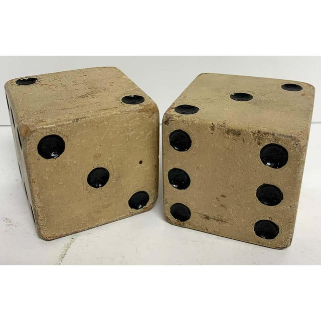 Pair of large scale vintage wooden casino dice, great size, color, and patina. Each one 2.25-inches square.