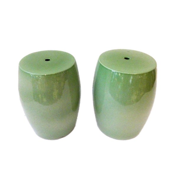 Superb pair of small Chinese celadon garden seats or side tables The surface is glazed with elegant green color. Besides...