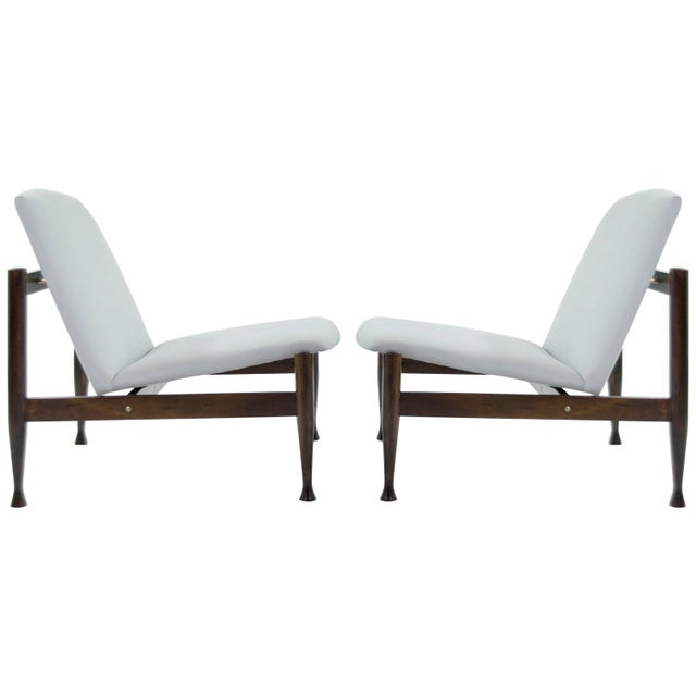 A fantastic pair of Danish Modern lounge chairs. Newly upholstered in a light blue linen. Walnut frames fully restored,...