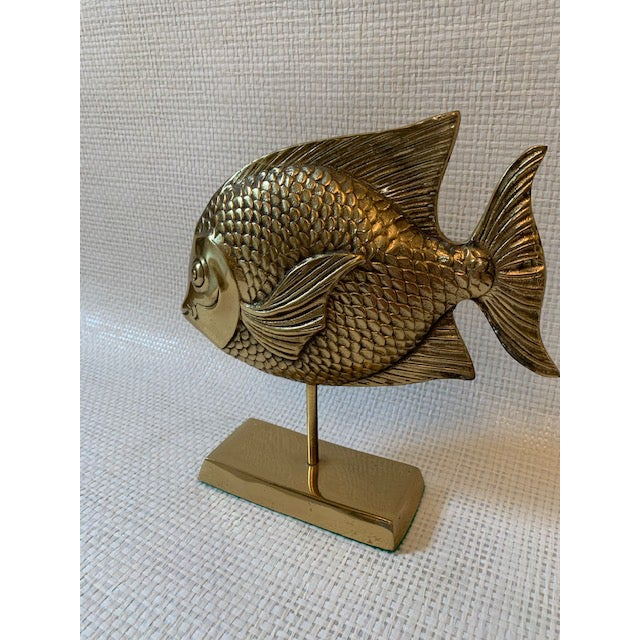 Tall, heavy brass rainbow fish on a brass stand. Fantastic on a bookshelf, console table! Great detailing.