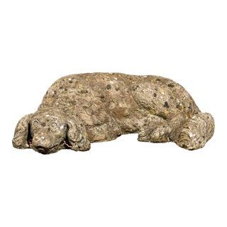 French Reclining Cast Stone Dog with Weathered Appearance from the 1930s