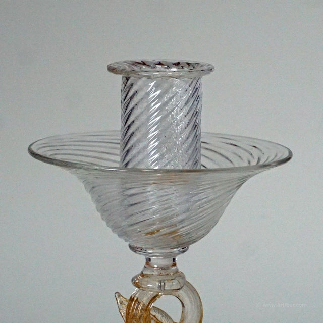 a great murano candle stick with dolphin sculpture. executed by archimede seguso ca. 1960ties. clear ribbed glass with...
