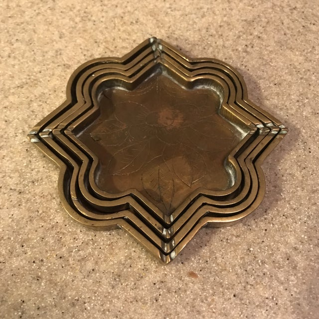 Each small tray has an etched floral design in bottom of tray. Believe these are Chinese. Very funky and cute look to...
