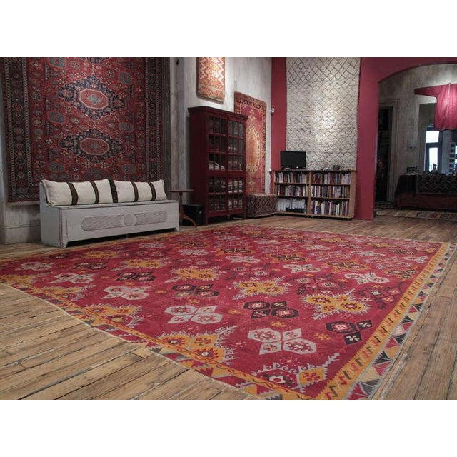 A large format antique Kilim from the Sivas Region in east-central Turkey with a well-known design but exceptional colors....